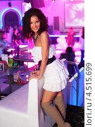Купить «Кудрявая брюнетка в белом платье на фоне ресторана», фото № 4515699, снято 28 октября 2011 г. (c) Losevsky Pavel / Фотобанк Лори