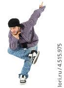 Купить «Молодой мужчина реппер в молодёжной одежде на белом фоне», фото № 4515975, снято 13 сентября 2011 г. (c) Losevsky Pavel / Фотобанк Лори