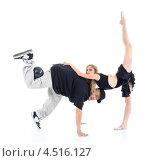 Купить «Гимнастка стоит на одной ноги и опирается на рэппера с мячом. Танцоры на белом фоне», фото № 4516127, снято 13 сентября 2011 г. (c) Losevsky Pavel / Фотобанк Лори