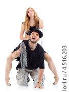 Купить «Девушка сидит на спине мужчины с цепью на шее», фото № 4516203, снято 13 сентября 2011 г. (c) Losevsky Pavel / Фотобанк Лори