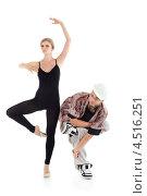 Купить «Изящная балерина и брейкдансер в каске», фото № 4516251, снято 13 сентября 2011 г. (c) Losevsky Pavel / Фотобанк Лори