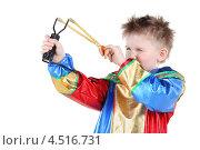 Купить «Мальчик в костюме клоуна стреляет из рогатки», фото № 4516731, снято 29 февраля 2012 г. (c) Losevsky Pavel / Фотобанк Лори