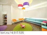 Купить «Интерьер комнаты с яркой мебелью, абажурами и уголком для детей», фото № 4517535, снято 25 июня 2011 г. (c) Losevsky Pavel / Фотобанк Лори