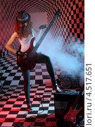 Купить «Девушка с бас-гитарой в студии на фоне из шахматных клеток», фото № 4517651, снято 10 декабря 2011 г. (c) Losevsky Pavel / Фотобанк Лори
