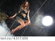 Купить «Сексуальная девушка в костюме ведьмы сидит на метле на фоне луны», фото № 4517659, снято 12 ноября 2011 г. (c) Losevsky Pavel / Фотобанк Лори