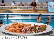 Купить «Салат из креветок в тарелке на палубе корабля у бассейна с людьми», фото № 4517799, снято 31 июля 2011 г. (c) Losevsky Pavel / Фотобанк Лори