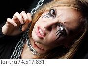 Купить «Девушка зомби с перерезанным горлом в чёрном на чёрном фоне», фото № 4517831, снято 12 ноября 2011 г. (c) Losevsky Pavel / Фотобанк Лори