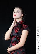 Купить «Молодая девушка в японской шелковой блузе на черном фоне», фото № 4517855, снято 12 ноября 2011 г. (c) Losevsky Pavel / Фотобанк Лори