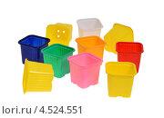 Купить «Цветные пластиковые горшочки для рассады», эксклюзивное фото № 4524551, снято 15 апреля 2013 г. (c) Юрий Морозов / Фотобанк Лори