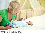 Купить «Бабушка и новорожденный внук», фото № 4532927, снято 3 апреля 2011 г. (c) Бандуренко Андрей / Фотобанк Лори
