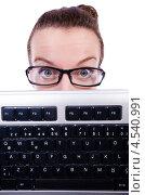 Купить «Женщина в очках с компьютерной клавиатурой», фото № 4540991, снято 11 марта 2013 г. (c) Elnur / Фотобанк Лори