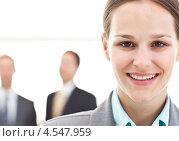 Купить «Молодая деловая женщина и два бизнесмена на заднем плане», фото № 4547959, снято 23 октября 2010 г. (c) Wavebreak Media / Фотобанк Лори