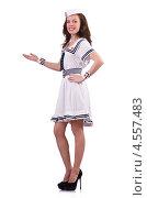 Купить «Девушка-хостес в белом морском костюме с демонстрационным жестом», фото № 4557483, снято 2 февраля 2013 г. (c) Elnur / Фотобанк Лори