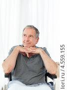 Купить «Пожилой мужчина в инвалидной коляске смотрит в сторону», фото № 4559155, снято 30 октября 2010 г. (c) Wavebreak Media / Фотобанк Лори
