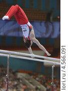 Купить «Lucas Fischer, Швейцария выполняет упражнения на брусьях на Чемпионате Европы по спортивной гимнастике», фото № 4566091, снято 21 апреля 2013 г. (c) Stockphoto / Фотобанк Лори