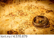 Купить «Компас лежит на старой карте», фото № 4570879, снято 26 апреля 2013 г. (c) Андрей Армягов / Фотобанк Лори