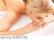 Купить «Красивая девушка лежит на животе в массажном салоне», фото № 4572135, снято 9 июня 2012 г. (c) Syda Productions / Фотобанк Лори