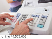 Купить «Руки кассира пробивают чек на кассовом аппарате», фото № 4573603, снято 4 марта 2012 г. (c) Андрей Попов / Фотобанк Лори