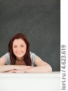 Купить «Девушка со сложенными перед собой руками на фоне доски», фото № 4623619, снято 25 мая 2011 г. (c) Wavebreak Media / Фотобанк Лори