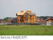 Купить «Строительство современного коттеджа», эксклюзивное фото № 4625571, снято 11 мая 2013 г. (c) Елена Коромыслова / Фотобанк Лори