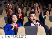 Купить «Удивленные зрители в креслах кинотеатра», фото № 4628215, снято 19 февраля 2013 г. (c) Raev Denis / Фотобанк Лори