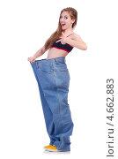 Купить «Радостная стройная девушка в джинсах большого размера», фото № 4662883, снято 12 апреля 2013 г. (c) Elnur / Фотобанк Лори