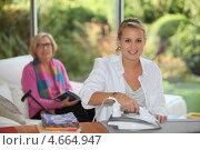 Купить «Девушка гладит в доме пожилой женщины», фото № 4664947, снято 26 октября 2010 г. (c) Phovoir Images / Фотобанк Лори