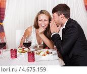 Купить «Влюбленные шепчутся о секрете в ресторане за ужином», фото № 4675159, снято 20 октября 2012 г. (c) Андрей Попов / Фотобанк Лори