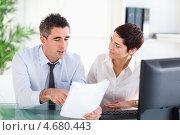 Купить «Мужчина и женщина обсуждают документы в офисе за столом», фото № 4680443, снято 3 августа 2011 г. (c) Wavebreak Media / Фотобанк Лори