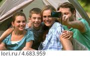 Купить «Happy family taking a photo of themselves», видеоролик № 4683959, снято 17 июля 2019 г. (c) Wavebreak Media / Фотобанк Лори