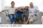 Купить «Happy family playing video games at home», видеоролик № 4685591, снято 22 июля 2019 г. (c) Wavebreak Media / Фотобанк Лори