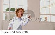 Boy in pajamas jumping and yelling in front of window. Стоковое видео, агентство Wavebreak Media / Фотобанк Лори