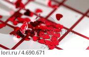 Купить «Heart confetti scattering on calendar», видеоролик № 4690671, снято 22 июля 2018 г. (c) Wavebreak Media / Фотобанк Лори
