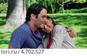 Купить «Smiling couple hugging each other while sitting on the grass», видеоролик № 4702527, снято 15 октября 2019 г. (c) Wavebreak Media / Фотобанк Лори