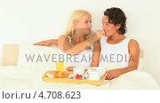 Купить «Happy couple having breakfast in bed», видеоролик № 4708623, снято 5 августа 2020 г. (c) Wavebreak Media / Фотобанк Лори