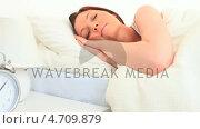 Купить «Attractive dark-haired woman sleeping», видеоролик № 4709879, снято 6 августа 2020 г. (c) Wavebreak Media / Фотобанк Лори