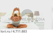 Купить «Blonde woman stretching herself», видеоролик № 4711883, снято 26 марта 2019 г. (c) Wavebreak Media / Фотобанк Лори