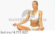 Купить «Cute woman meditating», видеоролик № 4711927, снято 26 марта 2019 г. (c) Wavebreak Media / Фотобанк Лори