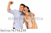 Купить «Cute couple taking a picture of themself», видеоролик № 4714219, снято 22 июля 2019 г. (c) Wavebreak Media / Фотобанк Лори