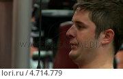 Купить «Dark-haired man doing exercise with a bodybuidling equipment», видеоролик № 4714779, снято 6 августа 2020 г. (c) Wavebreak Media / Фотобанк Лори