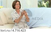 Купить «Retired woman reading the instructions of his medicine», видеоролик № 4716423, снято 5 августа 2020 г. (c) Wavebreak Media / Фотобанк Лори