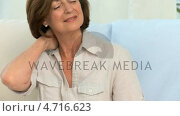 Купить «Elderly woman with a neck pain», видеоролик № 4716623, снято 5 августа 2020 г. (c) Wavebreak Media / Фотобанк Лори