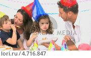 Купить «Family enjoying a birthday party», видеоролик № 4716847, снято 17 июля 2019 г. (c) Wavebreak Media / Фотобанк Лори