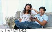 Купить «Desperate woman being bored while her boyfriend is playing a video game», видеоролик № 4719423, снято 5 августа 2020 г. (c) Wavebreak Media / Фотобанк Лори