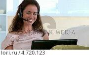 Купить «Smiling woman having talk by means of computer », видеоролик № 4720123, снято 5 августа 2020 г. (c) Wavebreak Media / Фотобанк Лори