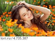 Купить «Красивая брюнетка в оранжевых цветах календулы», фото № 4735387, снято 24 апреля 2013 г. (c) Photobeauty / Фотобанк Лори