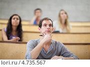 Купить «Внимательный студент и его однокурсники на лекции», фото № 4735567, снято 2 сентября 2011 г. (c) Wavebreak Media / Фотобанк Лори