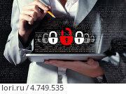 Купить «Женщина держит планшет и вводит пароль. Концепция компьютерной безопасности», фото № 4749535, снято 28 февраля 2013 г. (c) Sergey Nivens / Фотобанк Лори