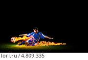 Купить «Футболист и горящий мяч на черном фоне», фото № 4809335, снято 26 апреля 2018 г. (c) Sergey Nivens / Фотобанк Лори