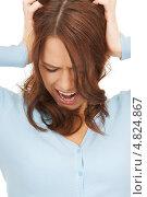 Купить «Эмоциональная девушка затыкает уши руками», фото № 4824867, снято 11 сентября 2010 г. (c) Syda Productions / Фотобанк Лори